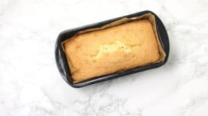 the baked cake in loaf pan.