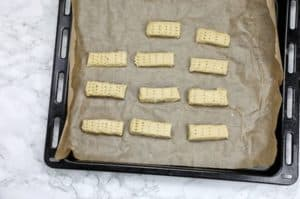 Dough shaped into rectanglar shapes and placed on baking tray.