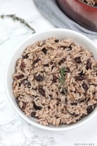 Jamaican rice and peas in a white plate.