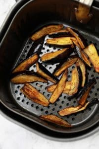 The cooked dish in the air fryer basket.